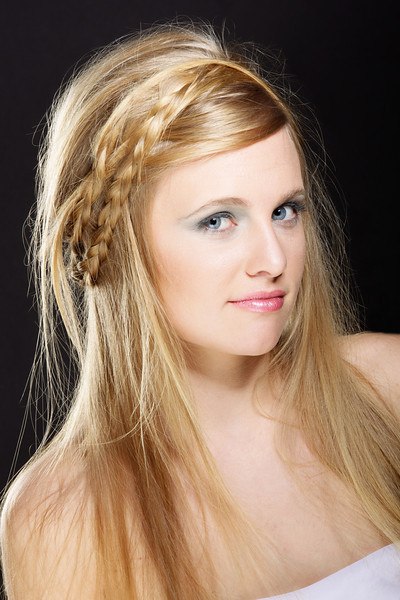 The imperfect loosely crafted braid gives the style somewhat of a mid evil type look.