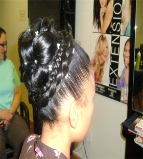 Sleek upstyle. This updo has a very neat sleek and well balanced look for your High School prom.